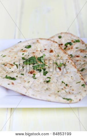 Traditional fresh baked naan bread with corriander