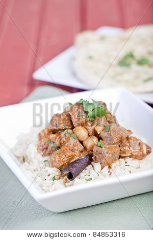 Beef curry served on a bed of rice