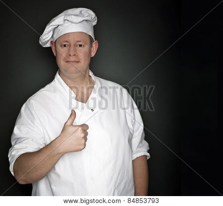 Male chef giving a positive thumbs up hand sign