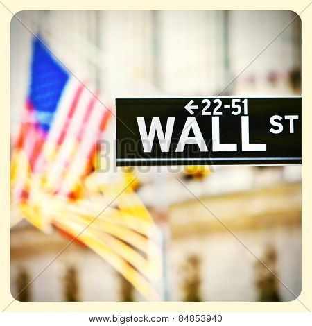 Wall street sign in New York with New York Stock Exchange background with Instagram effect filter