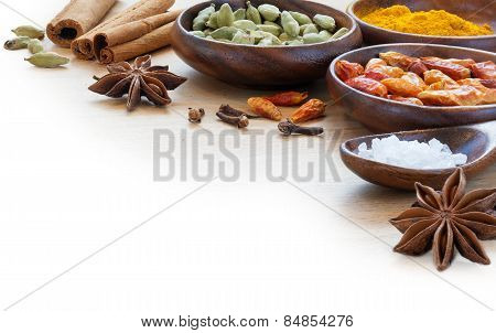 Exotic Spices In Wodden Bowls, Corner Background Blurred To White