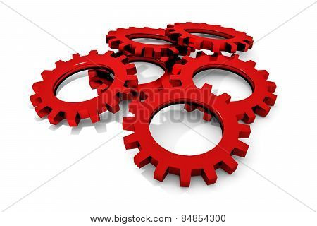 Stack Of Red Colored Metallic Cogwheels On White Surface