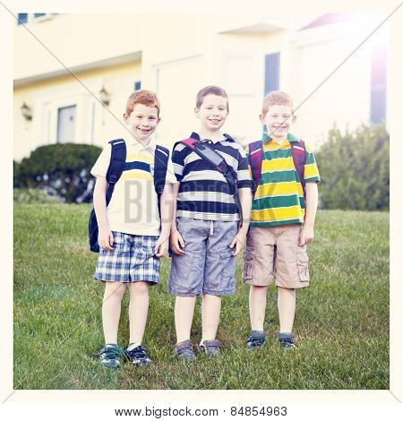 Boys first day of school with backpacks