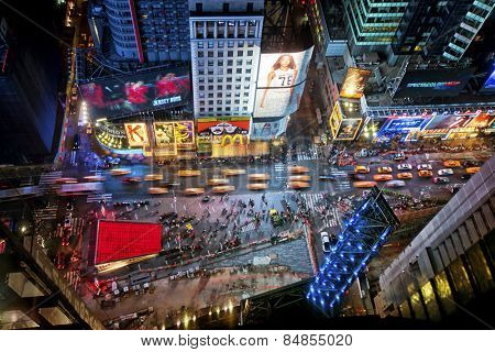 NEW YORK CITY, USA - JUNE 29th, 2014: Aerial view of Times Square the popular New Year's Eve destination with crowds and taxi cabs in motion in New York City.