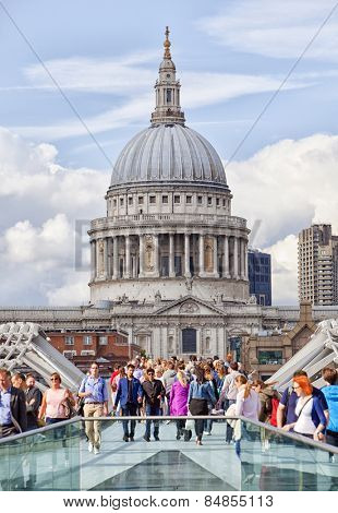 LONDON, UK - AUGUST 22, 2014: St Paul's Cathedral across the Millennium Bridge.