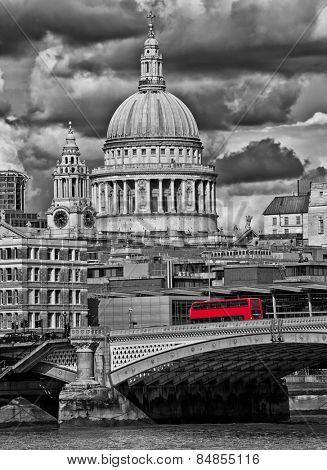 Red bus crossing a London bridge