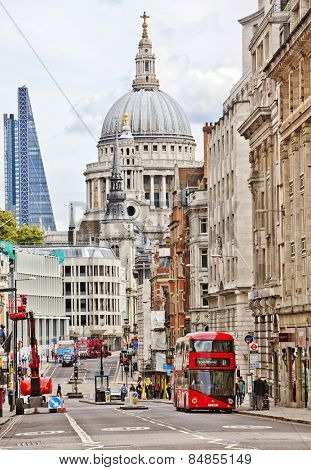 LONDON, UK - AUG 24, 2014: St Paul's Cathedral in the background of a busy street.