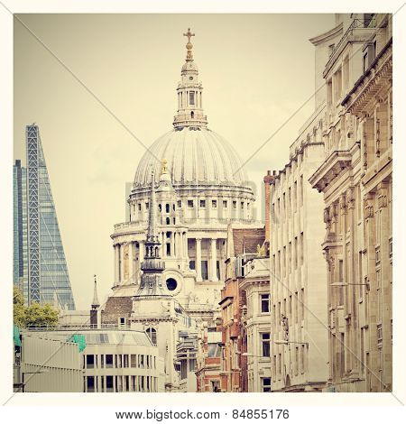 St Paul's Cathedral in the background of a busy street with Instagram effect filter