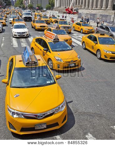 New York, USA - JUNE 28th, 2014: A crowded street full of iconic New York City taxi cabs