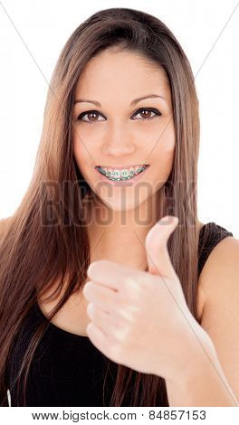 Smiling teenager girl with brackets saying Ok isolated on a white background