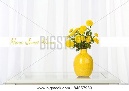 Beautiful flowers in vase on window background and space for your text