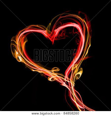 Abstract smoke in shape of heart isolated on black