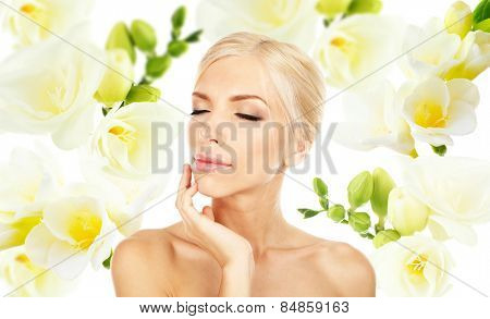 Beautiful young woman on freesia flower background
