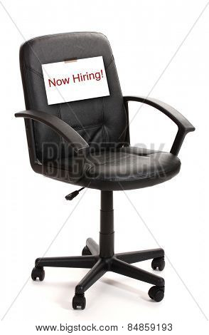 Black office chair with Now Hiring sign isolated on white