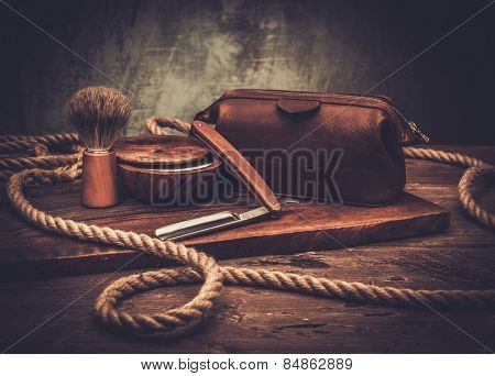 Shaving accessories on a luxury wooden background