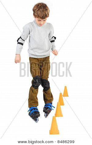 Little Boy Rollerblading Near Orange Cones Looking Down Isolated On White