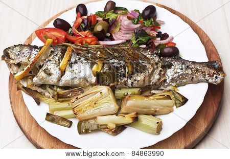 Cooking trout fish with lemon.