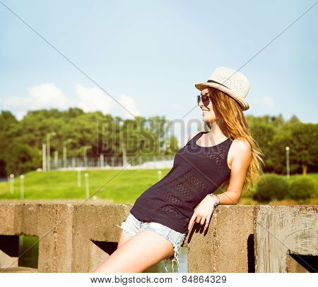Trendy Hipster Girl Relaxing in the Park