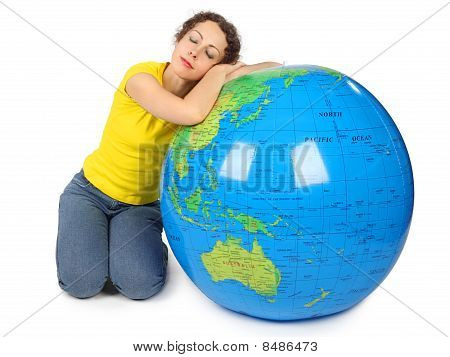 Young Beauty Woman Sitting Near Big Inflatable Globe With Closed Eyes, Head On Globe, Isolated