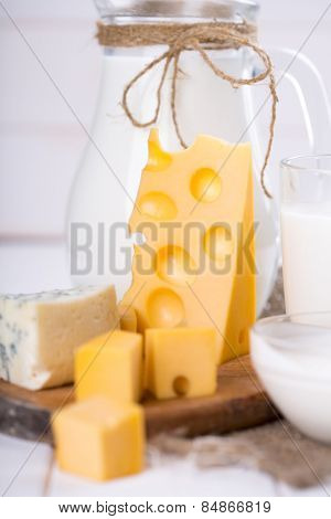 Fresh dairy products on an old kitchen board.