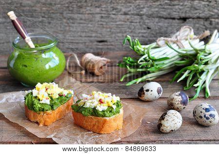 Ramson, wild garlic and sauce pesto sandwich on a wooden table