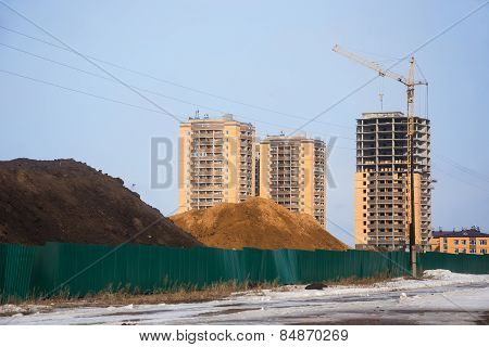 Heaps Of Chernozem And Sand Behind Fence On Building Site