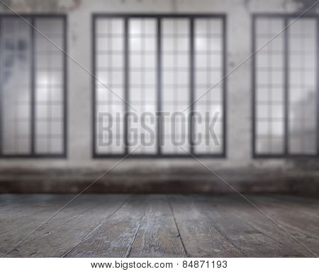 vintage blurred background. old room with concrete wall, wooden floor and big windows