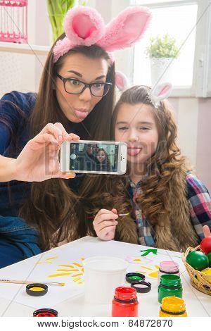 Easter - Mother and daughter with bunny ears made Selfie photo