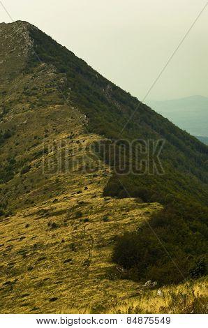 Hillside with trekking path to Trem peak at Suva Planina mountain