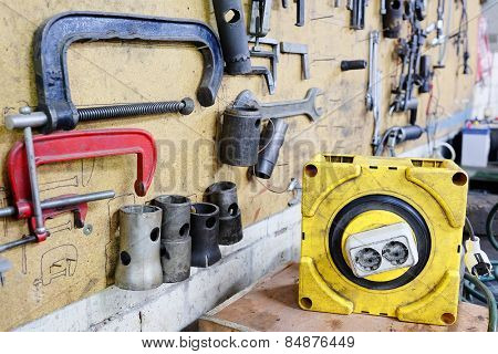 Car repair workshop tools on the wall