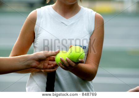 Tennis player shares tennis balls