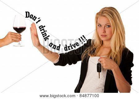 beautiful blond woman gesturing don't drink and drive gesture, with refusing a glass of wine