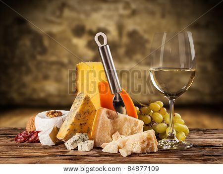 Various kind of cheese with white wine