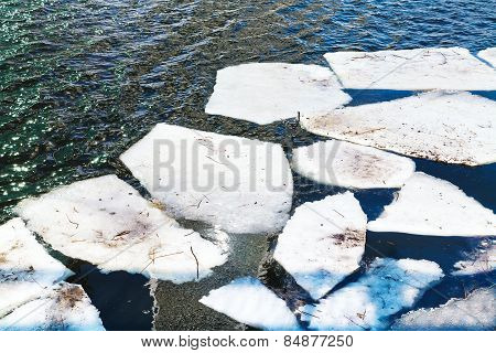 Melting Ice Floes In River In Spring