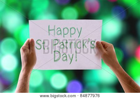 Happy St Patricks Day card with colorful background with defocused lights