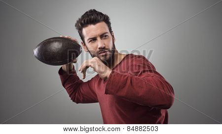 Football Player Launching Ball