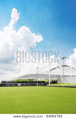 Kallang,Singapore-July 1,2014:Singapore indoor stadium exterior and cloudscape.The Singapore Indoor Stadium is an indoor sports arena, located in Kallang, Singapore.