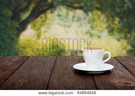 Coffee On Wooden Table With Beautiful Forrest Background