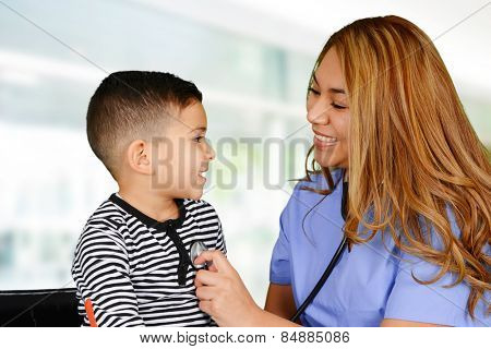 Female nurse working at her office with a patient