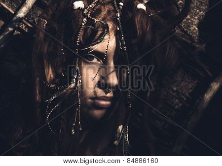 Close up Portrait of Woman With Stylish Dreadlocks Looking at the Camera.
