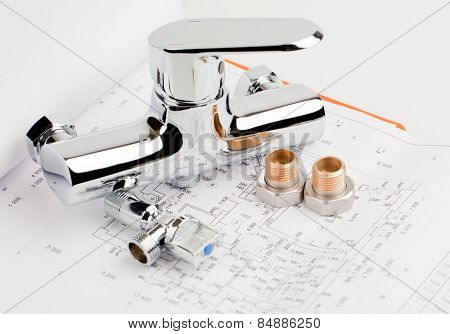 shower faucet, plumbing and tools lying on drafting for repair