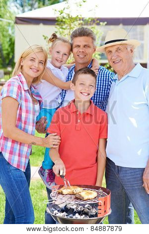 Family of five having barbecue outdoor