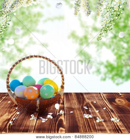 Easter eggs in the nest on rustic wooden table
