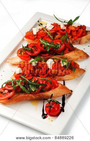 Italian Bruschetta Appetizer on the white plate