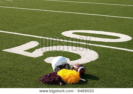 American Football Equipment And Pom Poms On Field
