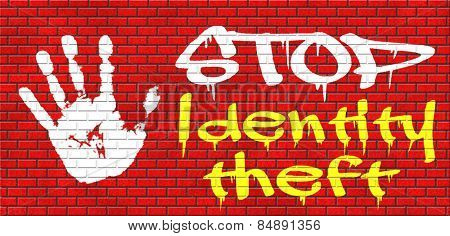 identity theft stop warning sign stealing ID online is an internet or cyber crime graffiti on red brick wall, text and hand