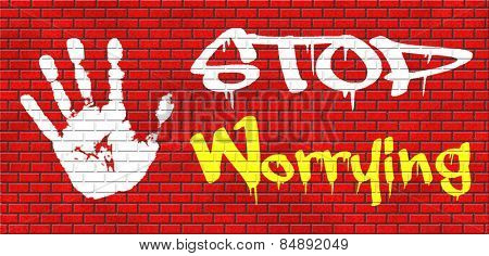 stop worrying no more worries solve all problems and relax keep calm and dont panic, panicking wont help just think positive and overcome problems graffiti on red brick wall, text and hand