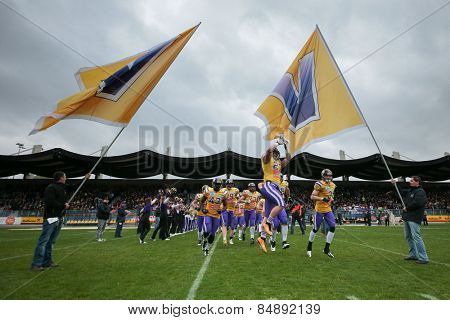 VIENNA, AUSTRIA - MARCH 23, 2014: The team of the Raiffeisen Vikings runs on the field before an AFL football game.