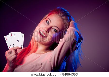 Beautiful caucasian woman with poker cards gambling in casino