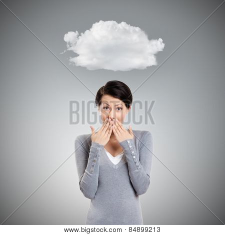 Wondered young girl, isolated on grey background with cloud